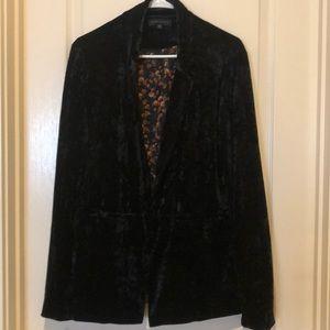 Black velvet blazer.